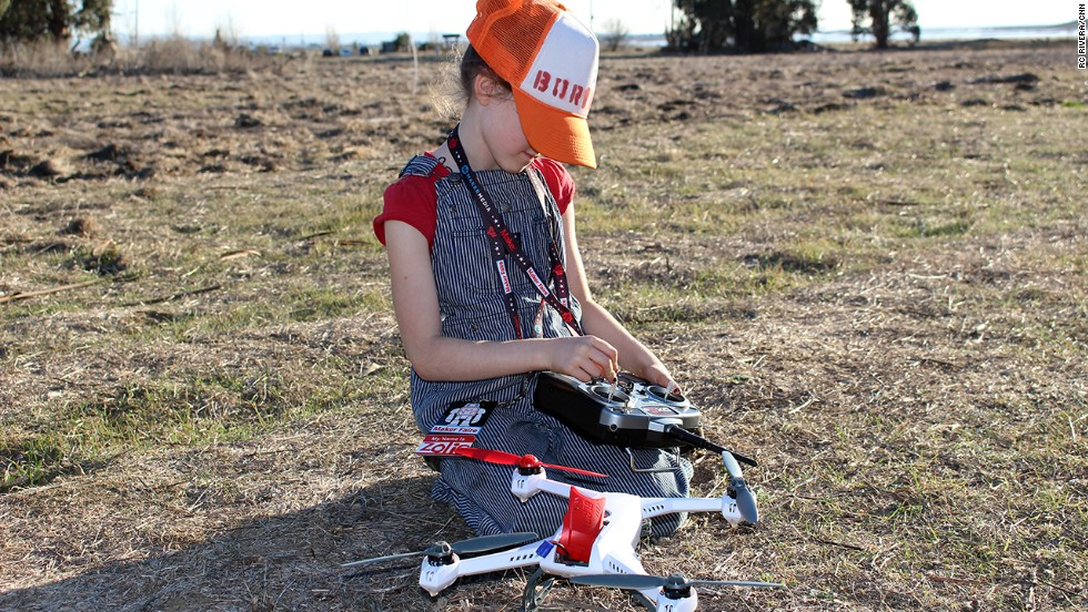 "Zolie Sarriugarte, 7, gets ready to take a drone for a spin. Sarriugarte likes drones because ""if there's a ball stuck up in a tree you can go fly over and knock the ball out."""