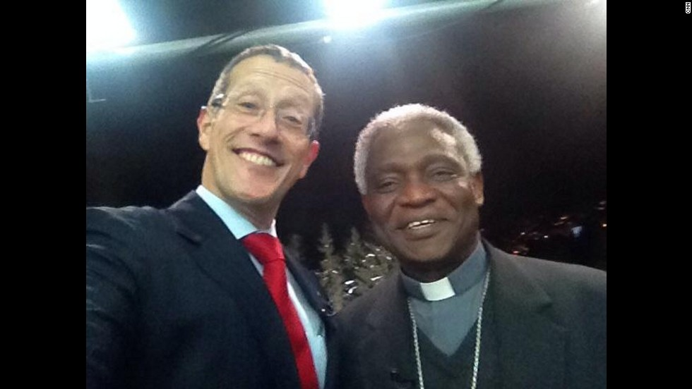 Richard Quest manages to snap a selfie with cardinal Turkson, as he brought a message from Pope to Davos.