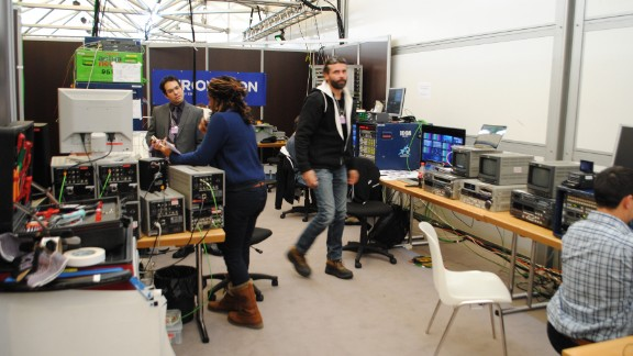 TV crews working upstairs at the Davos media centre. Behind the scenes Eurovision's technical support team at the Davos media centre.