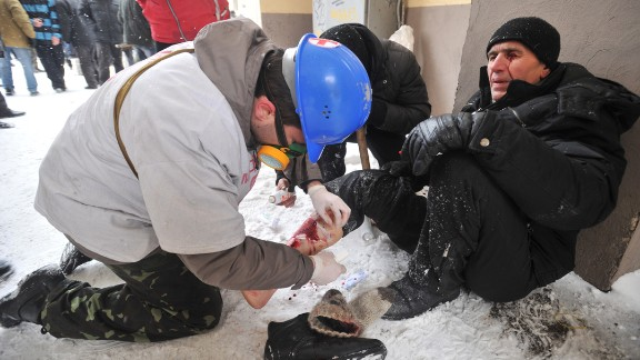 A medic treats an injured protester