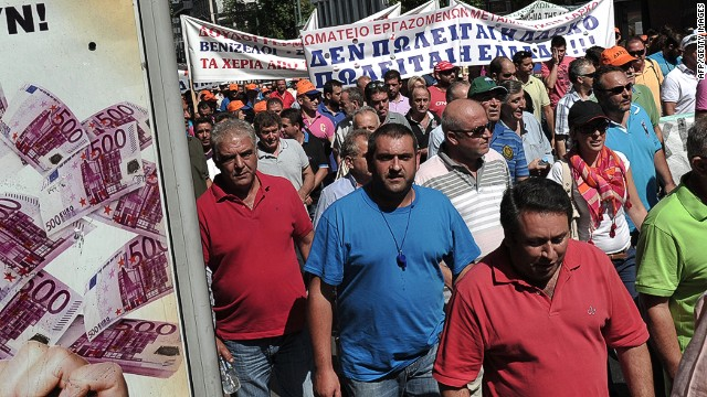 Workers at the large state-run mining and metallurgical company LARKO march by a lottery advertisement during their protest rally in ceNtral Athens on September 10, 2013 against the privatisation of the company which threatens their jobs. Greece has received massive rescue funding, tied to tough conditions, from the EU and the IMF to help it overcome a debt crisis which threatened the eurozone AFP PHOTO/ LOUISA GOULIAMAKILOUISA GOULIAMAKI/AFP/Getty Images