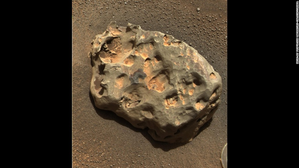 Opportunity discovered the first meteorite identified on a planet other than Earth. The rover's panoramic camera photographed the basketball-size object mostly composed of iron and nickel on January 6, 2005.