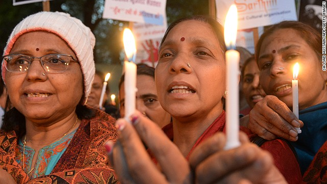 Indian demonstrators hold candles in honour of a physiotherapy student who was gang-raped and murdered at a protest to mark the one year anniversary of her death in New Delhi on December 29, 2013.