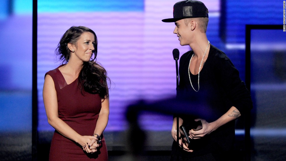 Bieber and his mother, Pattie Mallette, are widely known to have a close relationship, with Biebs never being shy about bringing mom to awards shows. Here, she joins him on stage as he accepts the 2012 American Music Award for Artist of the Year.