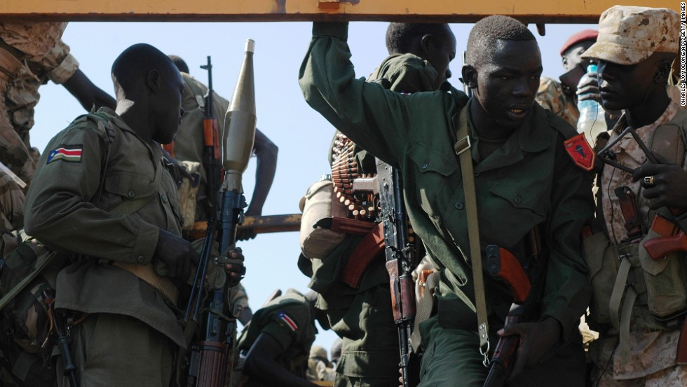 Government soldiers prepare to deploy from Juba on January 13 as fighting continues to rage in South Sudan.