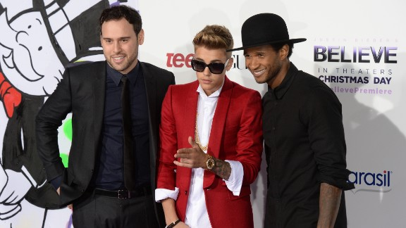 Justin Bieber is rarely spotted without a crew of a few friends, which sometimes also includes his longtime manager, Scooter Braun (pictured left). Along with R&B singer Usher, right, Braun has served as something of a mentor and guide to Bieber as he