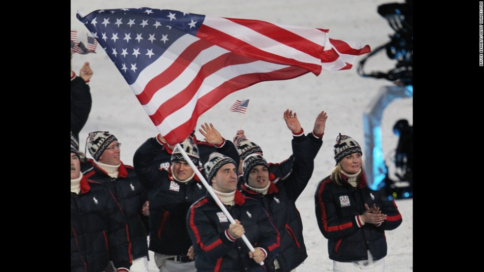U.S. athletes at the 2010 Winter Olympics in Vancouver, British Columbia. Luger Mark Grimmette carries the flag in the opening ceremony.
