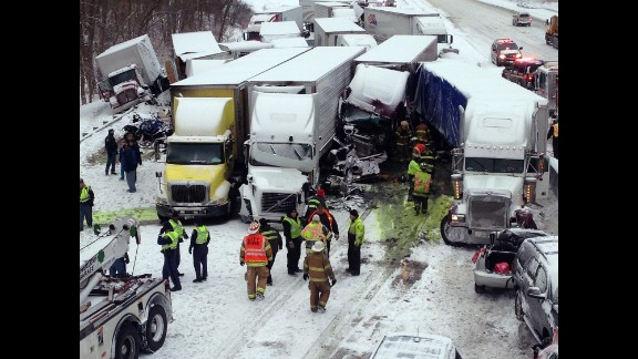 Emergency crews work at the scene of a massive pileup involving about 15 semitrailers and about 15 passenger vehicles and pickup trucks along Interstate-94 near Michigan City, Indiana, on January 23, in this photo provided by the Indiana State Police.