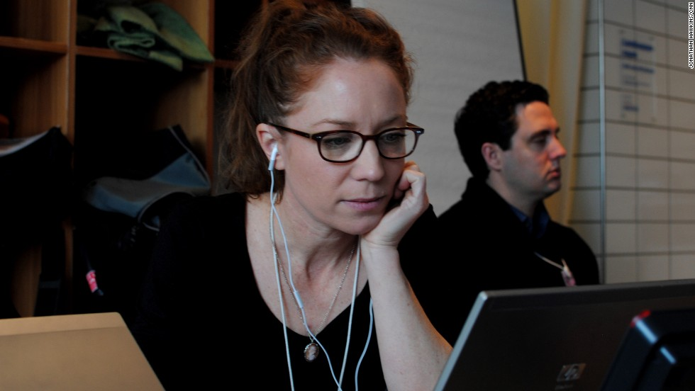 Irene Chapple, CNN digital producer, is working on her story in CNN's makeshift Davos bureau.