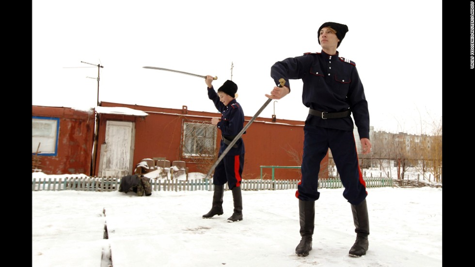 Young Russian Cossacks juggle swords in the town of Krasny Oktyabr, on the outskirts of the southern Russian city of Volgograd, in January 2014. Even before Russia was declared the host of the Winter Olympic Games, Cossacks were deployed to southern Russia to help maintain law.
