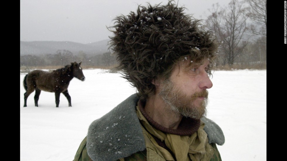 A Cossack settler stands in Pagran-Petrovka in Russia's Far East near the border with China in January 2001.  Russia deployed a chain of Cossack border guards to prevent Chinese citizens from crossing the border illegally.