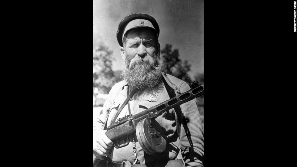 When World War II broke out, Cossack soldiers fought on both sides.  This 1943 photo shows a 64-year-old Russian Cossack decorated for gallantry and leadership with the order of the red banner