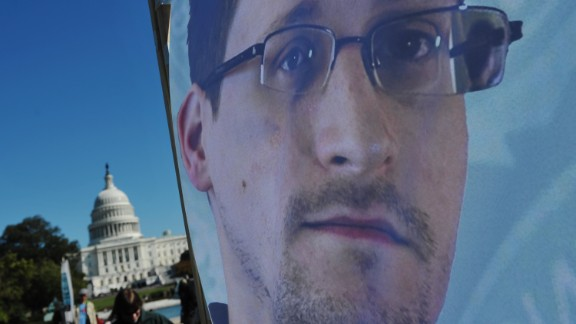 An image of Edward Snowden on the back of a banner is seen infront of the US Capitol during a protest against government surveillance on October 26, 2013 in Washington, DC.