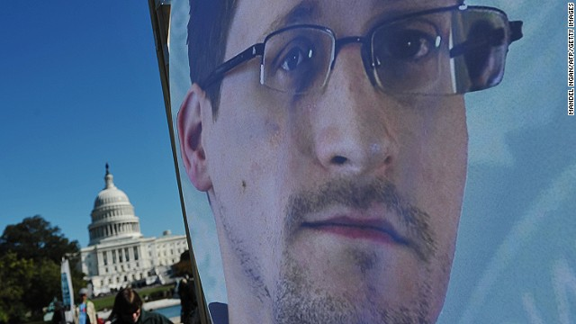 An image of Edward Snowden on the back of a banner is seen infront of the US Capitol in October 2013.