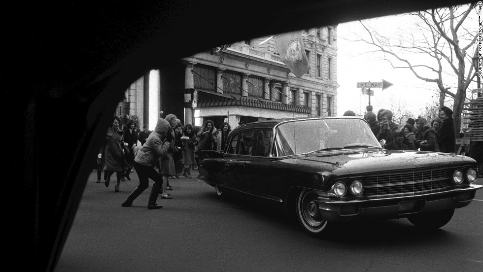 A car belonging to The Beatles is besieged by fans in New York on February 10, 1964.