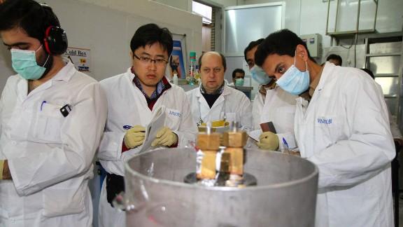 IAEA inspectors and Iranian technicians at the Natanz facility, Iran, on January 20, 2014.