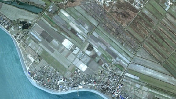 """The satellite image company DigitalGlobe and Google Earth have provided a look at the transformation of the location of the Winter Games in Sochi, Russia.  Look at how the area, known as the """"Coastal Cluster"""" has been transformed for the games. Here you can see the area where the Olympic Village will be built as it it appeared in April 2005."""