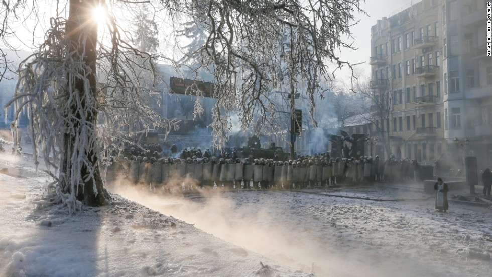 Riot police officers stand in line during anti-government protests in Kiev on Saturday, January 25.