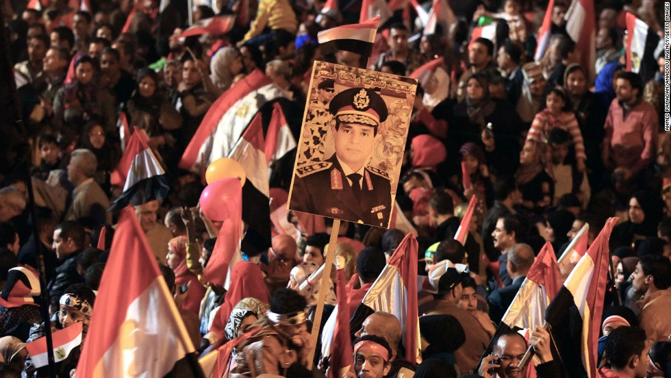 Supporters of Abdel-Fattah el-Sisi, Egypt's minister of defense, gather at Tahrir Square to mark the anniversary.