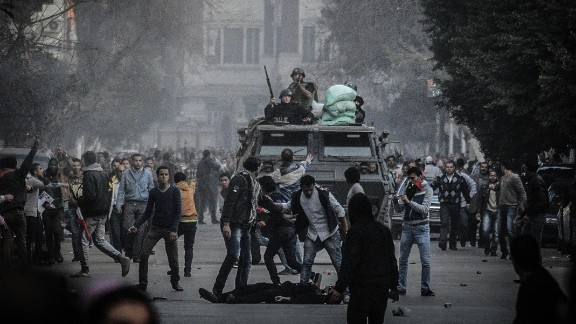 Egyptian police fire tear gas to disperse hundreds of supporters of ousted President Mohammed Morsy.