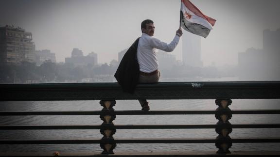 A man waves an Egyptian flag during a rally.