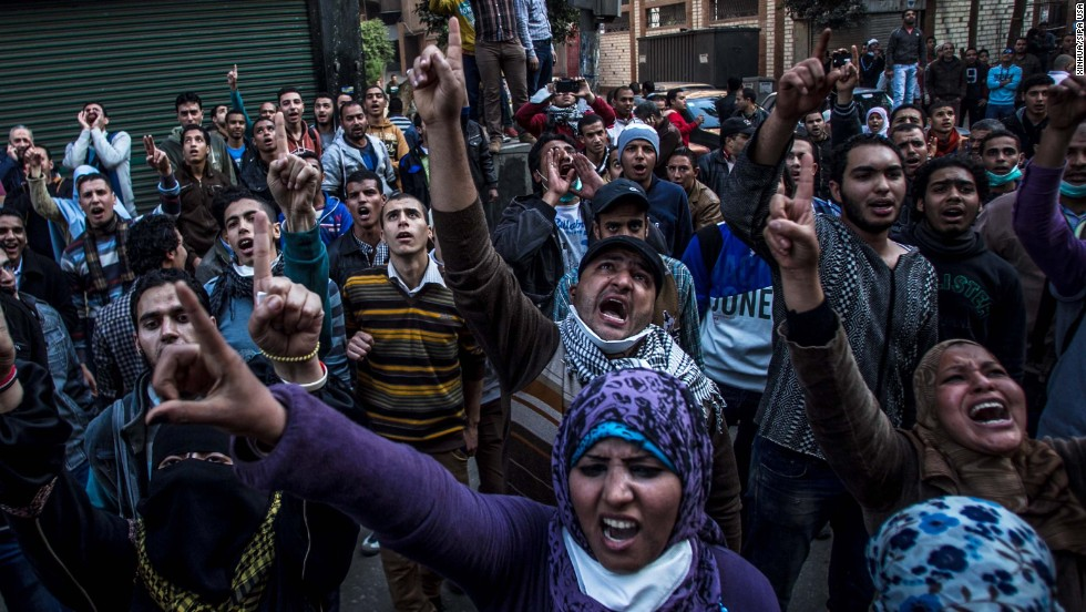 Anti-military protesters shout slogans near the Ramses Square in downtown Cairo.