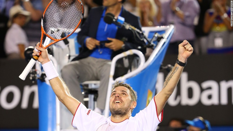 Stanislas Wawrinka savors the moment of victory in Melbourne after recording a dramatic victory over world no. 1 Rafael Nadal in 2014.