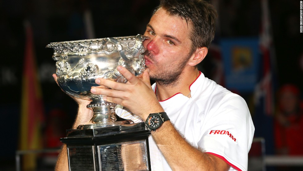 The 28-year-old Wawrinka kisses the Norman Brookes Challenge Cup as flashbulbs pop all around the Rod Laver Arena.