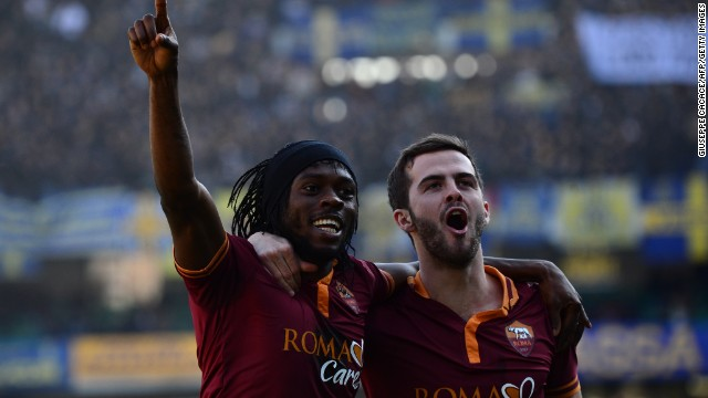 Roma striker Gervinho (left) celebrates with teammate Miralem Pjanic after scoring in a 3-1 win against Hellas Verona.