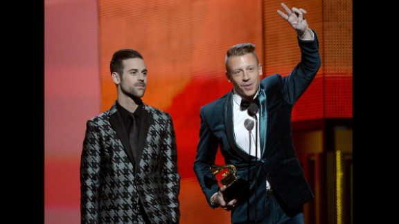 LOS ANGELES, CA - JANUARY 26:  Rappers Ryan Lewis (L) and Macklemore accept the Best New Artist award onstage during the 56th GRAMMY Awards at Staples Center on January 26, 2014 in Los Angeles, California.  (Photo by Kevork Djansezian/Getty Images)