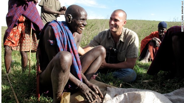 Nigel Barker trying to convince the local medicine man on the Maasai Steppe to let him speak to women in the tribe who deliver the babies.