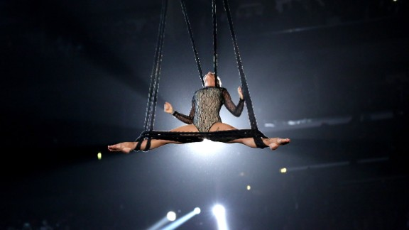 """Pink shows off her aerial acrobatics while performing """"Just Give Me a Reason."""" She opened her set with the song """"Try."""""""