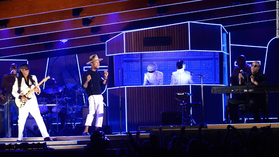 "From left, Nile Rodgers, Pharrell Williams, Daft Punk and Stevie Wonder rock the crowd with a set that included the 2013 single ""Get Lucky."" The song won record of the year. Daft Punk also won album of the year for ""Random Access Memories."""