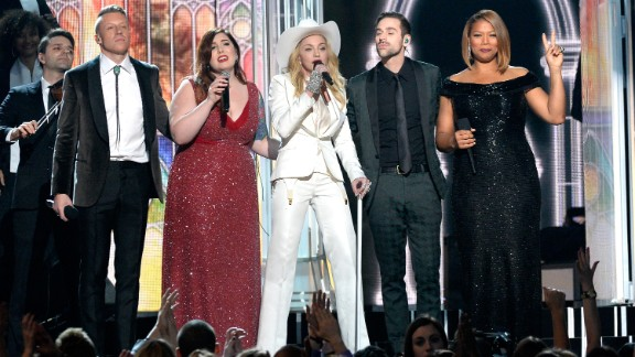 """From right, Queen Latifah, Ryan Lewis, Madonna, Mary Lambert and Macklemore share the stage. Madonna sang her classic """"Open Your Heart."""""""