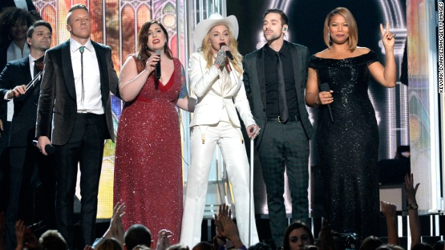 "From left, Macklemore, Mary Lambert, Madonna, Ryan Lewis and Queen Latifah share the stage. Madonna sang her classic ""Open Your Heart"" after the performance of Macklemore and Ryan Lewis' ""Open Your Heart."""