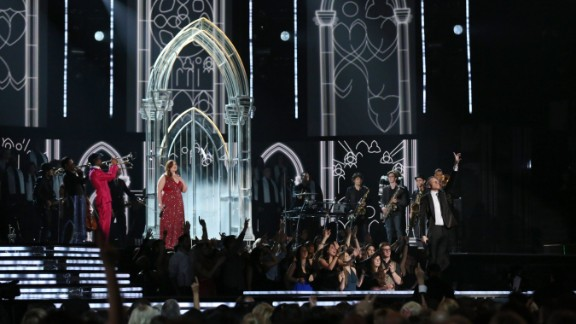 """Mary Lambert joins Macklemore for the performance of """"Same Love."""" Earlier in the night, Macklemore and Lewis won the Grammy for best new artist."""