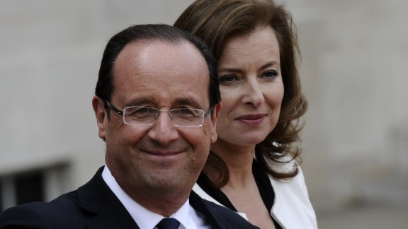 France's president Francois Hollande and his companion Valerie Trierweiler leave the Elysee presidential Palace in Paris, May 15, 2012.