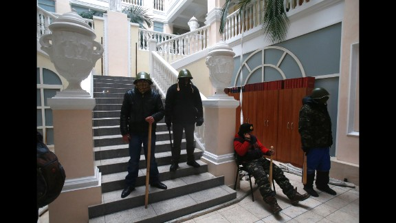 Protesters stand guard inside the Ukraine Justice Ministry in Kiev on January 27. Demonstrators later left the building because they didn