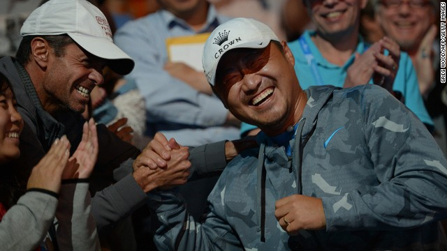 Jiang Shan (on the right) celebrates with Li Na's coach Carlos Rodriguez after she won the 2014 Australian Open