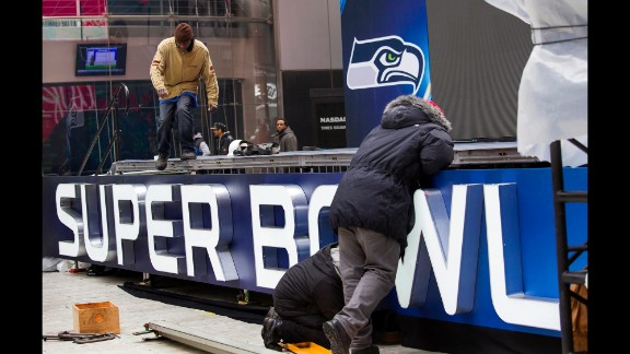 Workers put together a stage structure for Super Bowl activities in Times Square on Monday, January 27.