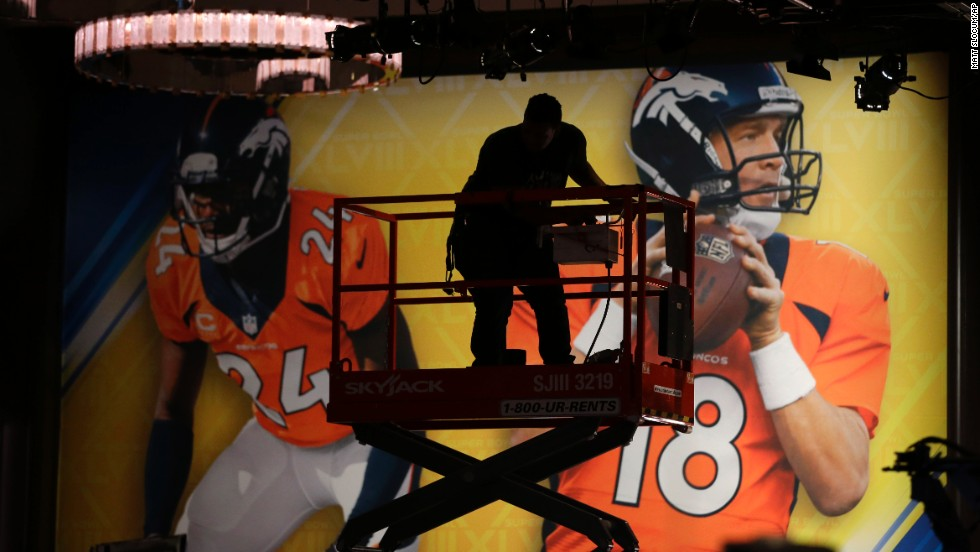 A man adjusts lights at the Super Bowl media center in New York on January 27.