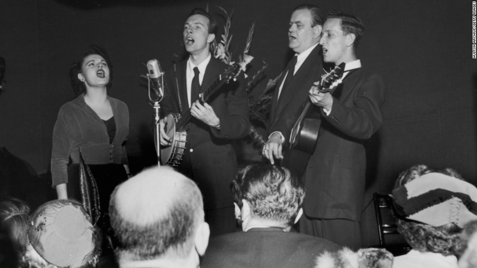 Seeger, center, performs with his group, the Weavers, at the Blue Angel nightclub in New York, circa 1948.