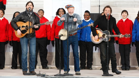 """Seeger performs with Tao Rodriguez-Seeger, left, and Bruce Springsteen, right, at """"We Are One: The Obama Inaugural Celebration At The Lincoln Memorial"""" in 2009."""