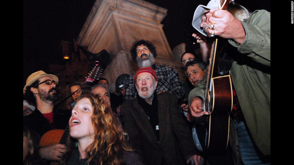 Seeger sings with Occupy Wall Street protesters in October 2011 in New York City.