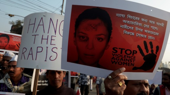 Indian Aam Admi Party (AAP) activists hold posters during a rally as they protest against the gangrape and murder of a teenager in Kolkata on January 5, 2014.