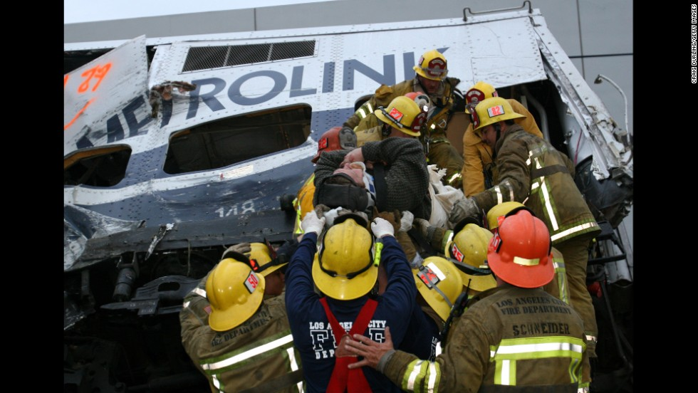 Rescue workers from Los Angeles tend to victims of an early morning Metrolink commuter train collision in Glendale, California, on January 26, 2005. Eleven people died and more than 180 were injured in the derailment, caused when Juan Manuel Alvarez parked his car on the tracks. Alvarez was convicted of murder and sentenced to 11 consecutive life terms in prison.