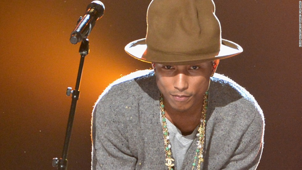 Pharrell Williams holds on to his hat at the taping of CBS' tribute to The Beatles on January 27.