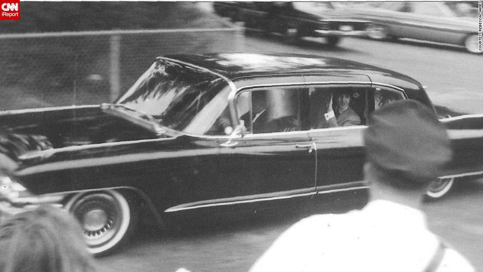 "James snapped this photo of Paul McCartney driving by in August 1964 while visiting her brother in Detroit. ""I heard screaming and learned that The Beatles were staying at a nearby hotel,"" she said. ""I took off and hung around the hotel driveway and was lucky enough to get that photo."" James recalls a girl fainting right in front of her -- a common sight during the height of Beatlemania."