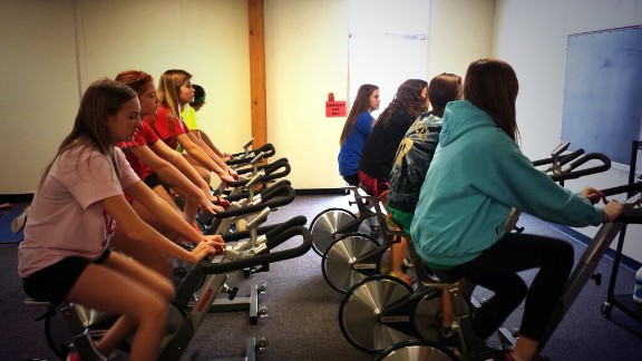 Students at  at Merton Intermediate School in Wisconsin participate in a spin class.