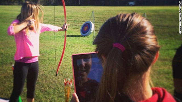 Students at Merton Intermediate School in Wisconsin analyze their archery skills using an iPad.